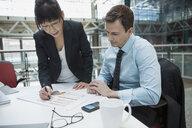 Business people reviewing data in meeting - HEROF07557