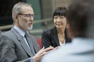Businessman gesturing in meeting - HEROF07605