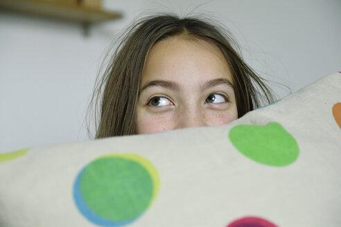 Girl hiding behind cushion - ECPF00276