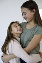 Two happy sisters hugging each other - ECPF00291