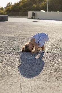 Playful little girl outdoors in summer - MAUF02426