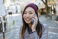 Portrait of smiling young woman on the phone - KIJF02223