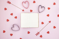 Valentines symbols and opened notebook on pink background - MOMF00589