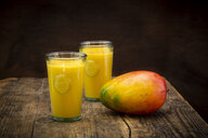 Mango and two glasses of Mango Lassi with curcuma - LVF07683