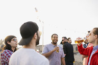 Friends drinking beer at rooftop party - HEROF07666