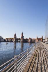Germany, Berlin-Kreuzberg, view to Oberbaum Bridge at sunlight - GWF05813