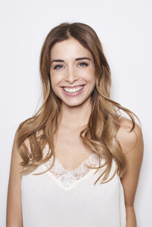 Portrait of laughing young woman wearing white top - PNEF01162