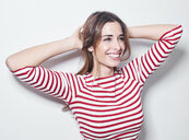 Portrait of laughing young woman wearing red-white striped shirt - PNEF01168