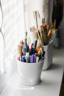 Pencils collected in vase on window sill - LSF00078
