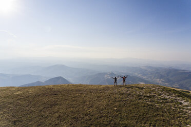 Italy, Monte Nerone, two hikers on top of a mountain enjoying the view - WPEF01295