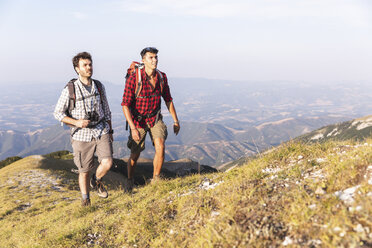 Italy, Monte Nerone, two men hiking in mountains in summer - WPEF01304