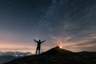 Italy, Monte Nerone, silhouette of a man looking at night sky with stars and milky way - WPEF01325