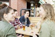 Happy friends enjoying at sidewalk cafe - ASTF02711
