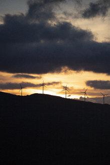 Spain, Andalusia, Tarifa, wind wheels on mountain at sunrise - KBF00460