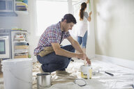 Couple starting painting project in living room - HEROF07865