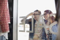 Hipster couple window shopping at storefront - HEROF07916