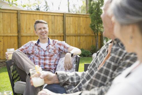 Friends drinking lemonade in backyard - HEROF07952