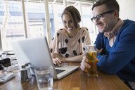Couple drinking and using laptop in bistro - HEROF07955