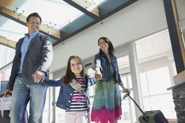 Daughter leading parents in airport - HEROF08012