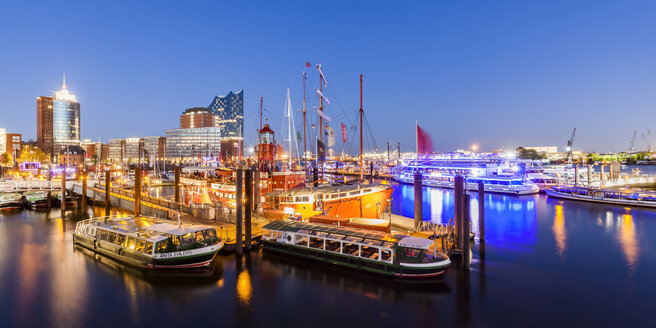 Germany, Hamburg, lighted marina and Niederhafen at twilight - WD05057