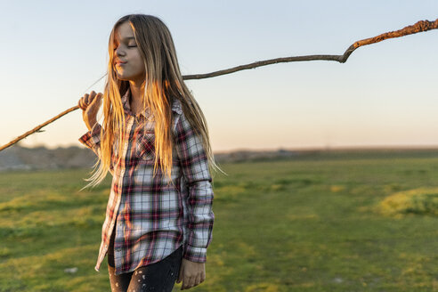 Girl with stick in nature - ERRF00681