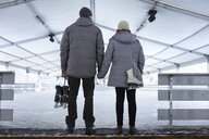 Couple standing at the ice rink - ZEDF01823