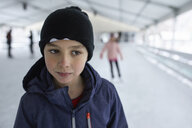 Portrait of a boy, wearing wooly hat, having fun ice skating on the ice rink - ZEDF01847