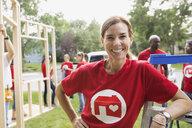 Portrait of confident volunteer near construction frame - HEROF08337