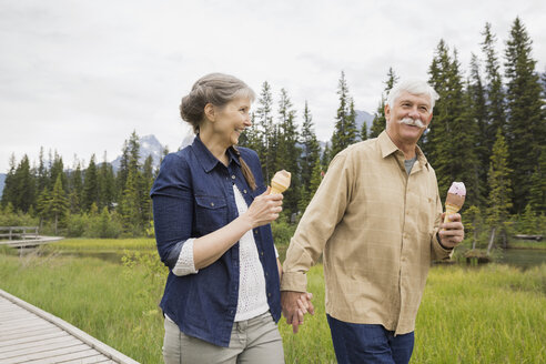 Older couple eating ice cream outdoors - HEROF08373