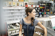 Confident female business owner working in art supply shop - HEROF08538