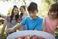 Kids bobbing for apples at summer neighborhood block party - HEROF08583