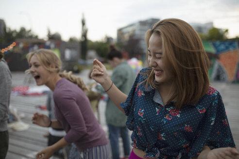 Laughing teenage girls in park - HEROF08643