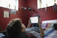 Latinx boy using digital tablet on boy - HEROF08679