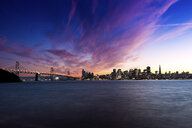 USA, California, San Francisco skyline and Oakland Bay Bridge at sunset - EPF00551
