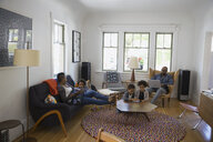 Family relaxing and using technology in living room - HEROF09509