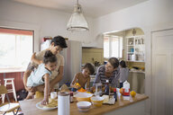 Family enjoying breakfast in kitchen - HEROF09524