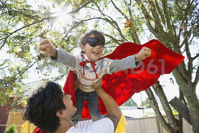 Father flying son in superhero cape overhead - HEROF09575 - Hero Images/Westend61