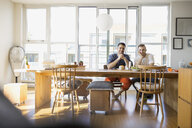 Portrait of confident homosexual couple at table - HEROF09590