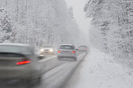Cars driving on country road in winter, driving snow - CRF02826