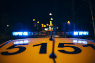 Spain, Madrid, close-up of police car sirens with the lights of the city in background - OCMF00232