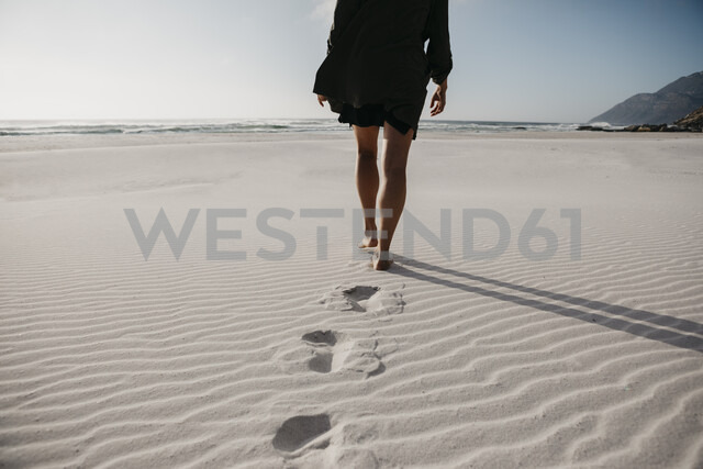 South Africa, Western Cape, Noordhoek Beach, back view of young woman strolling on the beach - LHPF00403 - letizia haessig photography/Westend61