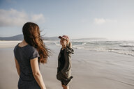 South Africa, Western Cape, Noordhoek Beach, two young women on the beach - LHPF00406