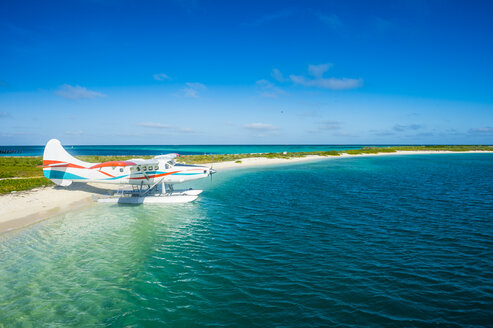 USA, Florida, Florida Keys, Dry Tortugas National Park, Water plane in the turquoise waters of Fort Jefferson - RUNF01030