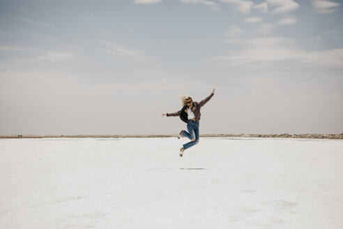 Namibia, Walvis Bay, woman jumping on a salt plain - LHPF00421