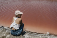 Namibia, Walvis Bay, woman sitting at Pink Lagoons - LHPF00424