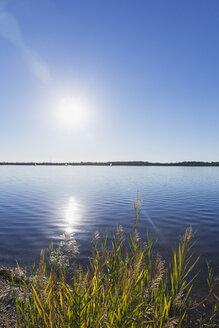 Germany, Saxony, Leipzig, Lake Cospuden in backlight - GWF05833