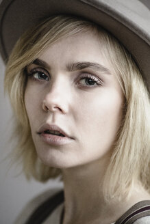 Portrait of blond young woman wearing hat - JESF00226