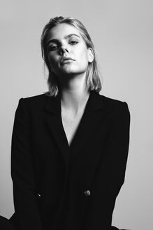 Portrait of blond young woman wearing black blazer - JESF00229