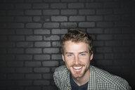 Portrait of enthusiastic man in plaid shirt - HEROF10098