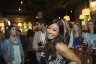 Portrait of smiling woman at bar - HEROF10137